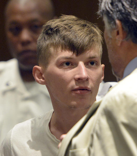 CORRECTS TO SPRINGFIELD NOT HAMPTON DISTRICT COURT - Volodymyr Zhukovskyy, 23, of West Springfield, stands during his arraignment in Springfield District Court, Monday, June 24, 2019, in Springfield, Mass. Zhukovskyy, the driver of a truck in a fiery collision on a rural New Hampshire highway that killed seven motorcyclists, was charged Monday with seven counts of negligent homicide.  (Don Treeger/The Republican via AP, Pool)