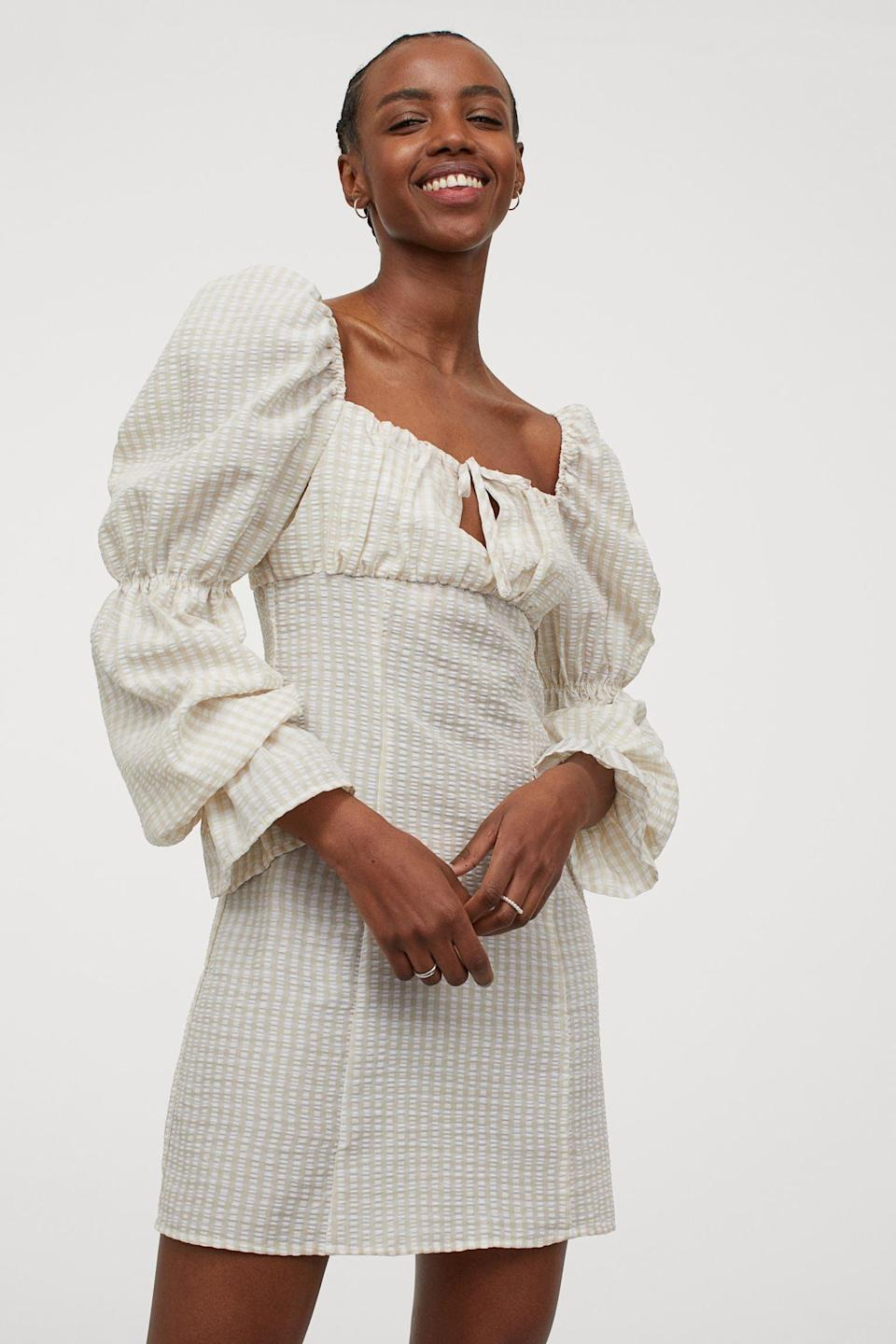 <p>This <span>Short Puff-sleeved Dress</span> ($25) can be worn with sneakers for a laidback look or strappy sandals for an elevated outfit.</p>