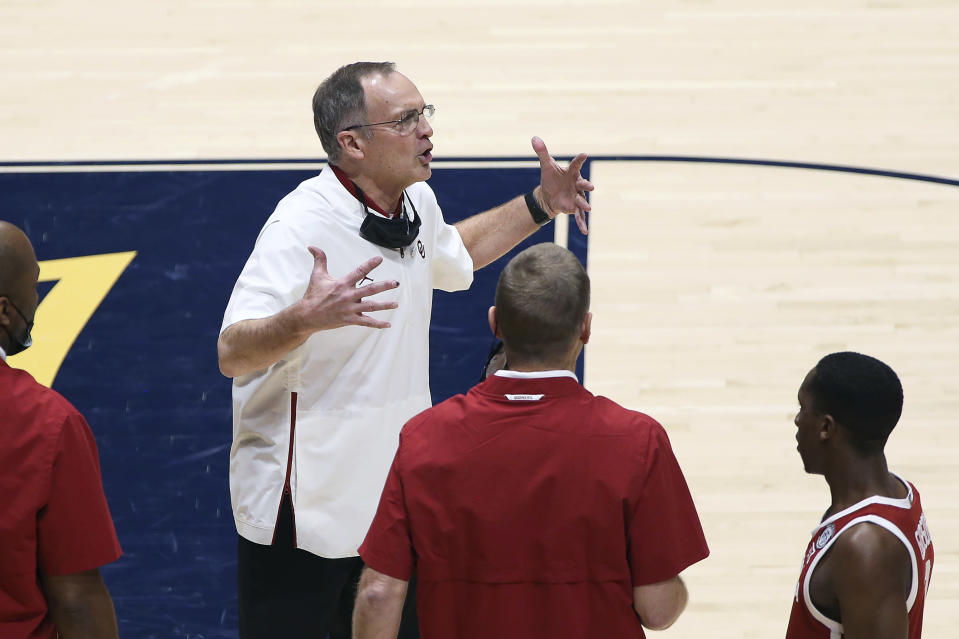 Oklahoma coach Lon Kruger reacts during the second half of an NCAA college basketball game against West Virginia, Saturday, Feb. 13, 2021, in Morgantown, W.Va. (AP Photo/Kathleen Batten)