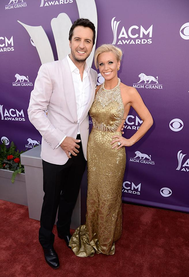 LAS VEGAS, NV - APRIL 07:  Host Luke Bryan (L) and Caroline Boyer attend the 48th Annual Academy of Country Music Awards at the MGM Grand Garden Arena on April 7, 2013 in Las Vegas, Nevada.  (Photo by Frazer Harrison/ACMA2013/Getty Images for ACM)