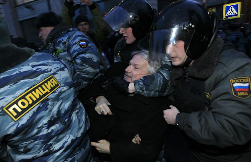 Russian police officers detain opposition leader Edouard Limonov during a protest near the Central Election Committee in Moscow, Monday, March, 5, 2012. Demonstrators are contesting the outcome of Russia's presidential election, pointing to a campaign heavily slanted in Putin's favor and to reports of widespread violations in Sunday's ballot. (AP Photo/Sergey Ponomarev)