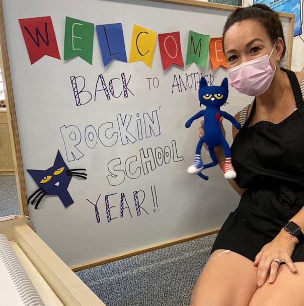 PHOTO: Angela Rivero, an ECSE teacher in Hawaii, poses in her classroom while wearing a face mask. (Courtesy Angela Rivero)