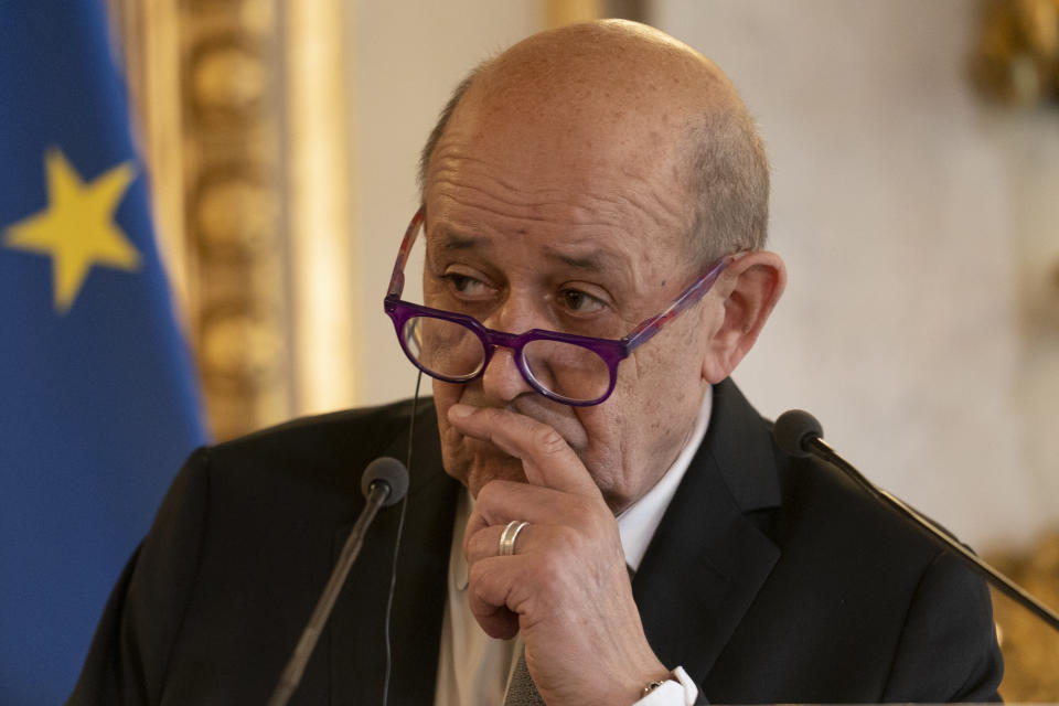 French Foreign Affairs Minister Jean-Yves Le Drian attends a news conference with US Secretary of State Antony Blinken at the French Ministry of Foreign Affairs in Paris, Friday, June 25, 2021. Blinken is on a week long trip in Europe traveling to Germany, France and Italy. (AP Photo/Andrew Harnik, Pool)