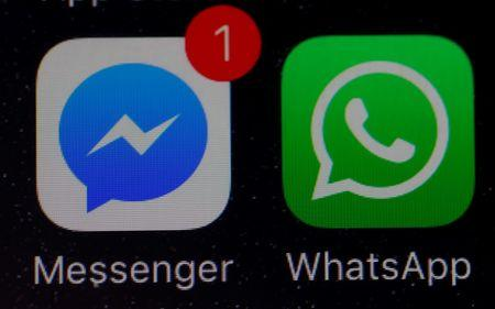WhatsApp and Facebook messenger icons are seen on an iPhone in Manchester , Britain.