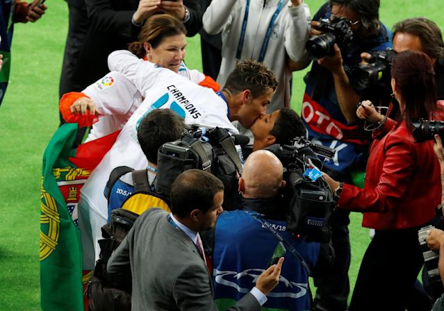 Soccer Football - Champions League Final - Real Madrid v Liverpool - NSC Olympic Stadium, Kiev, Ukraine - May 26, 2018 Real Madrid's Cristiano Ronaldo celebrates with his mother Maria Dolores dos Santos Aveiro and his son after winning the Champions League REUTERS/Phil Noble