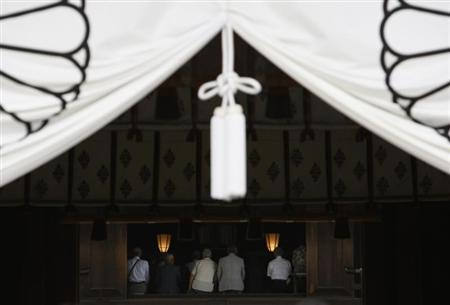 People pray at the Yasukuni Shrine in Tokyo