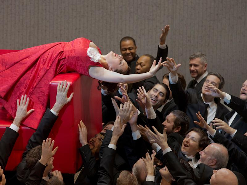 """In this March 7, 2013 photo provided by the Metropolitan Opera Diana Damrau performs as Violetta in a scene from scene from Act I of Verdi's """"La Traviata"""" during a rehearsal at the Metropolitan Opera in New York. (AP Photo/ Metropolitan Opera, Ken Howard)"""