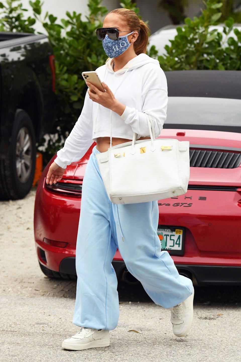 <p>Jennifer Lopez dresses comfortably in a blue-and-white outfit after leaving her Miami gym to eat lunch at Havana Harry's on Tuesday.</p>