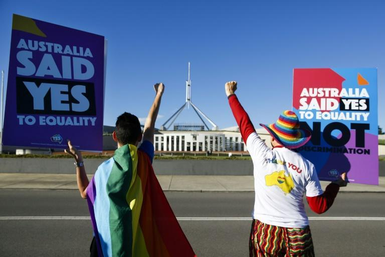 Same-sex marriage campaigners cheer in front of Australia's parliament ahead of the vote