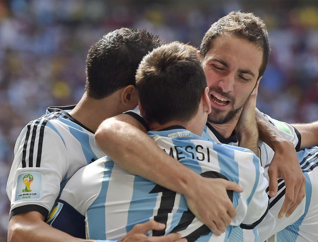 Argentina's Gonzalo Higuain, right, embraces Lionel Messi after he scored the opening goal against Belgium during the World Cup quarterfinal soccer match between Argentina and Belgium at the Estadio Nacional in Brasilia, Brazil, Saturday, July 5, 2014. (AP Photo/Martin Meissner)