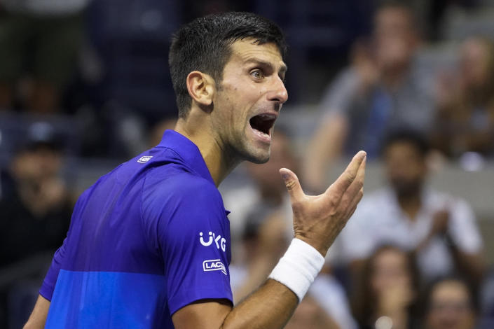 Novak Djokovic, of Serbia, reacts after losing a point to Alexander Zverev, of Germany, during the semifinals of the US Open tennis championships, Friday, Sept. 10, 2021, in New York. (AP Photo/John Minchillo)