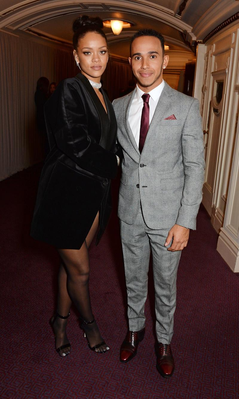 Rihanna was spotted with race-car driver Lewis Hamilton at several events, including the the 2014 British Fashion Awards, but Hamilton claimed the two were just friends.
