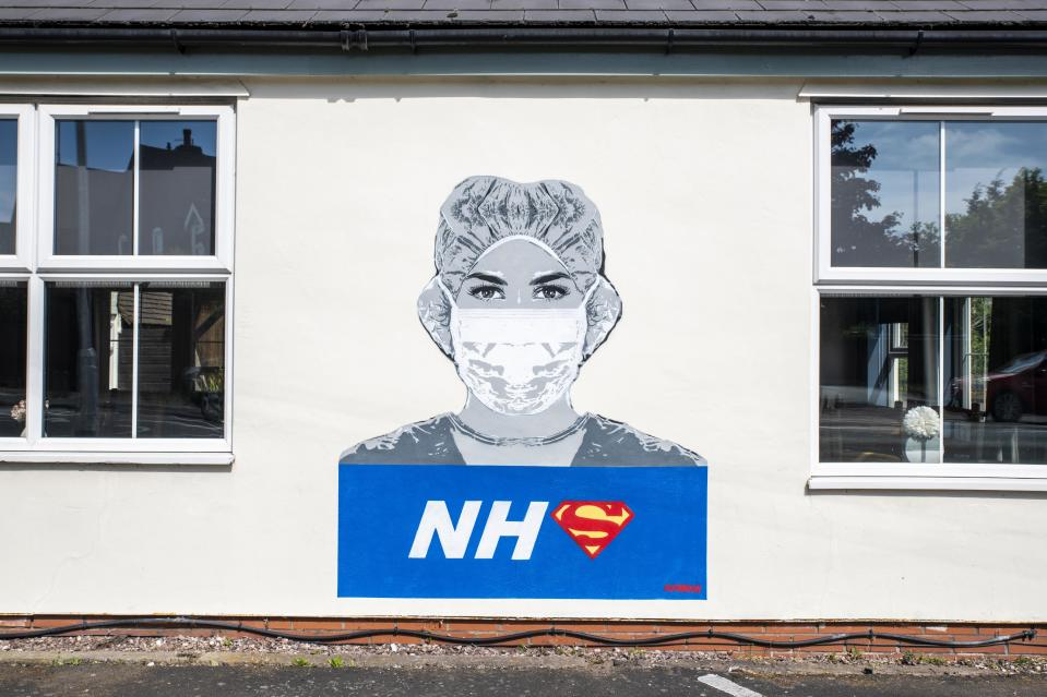 A piece of street art of a nurse in honour of NHS staff during the coronavirus pandemic, recently painted by street artist John D�oh, on a wall of The Bull Inn in Fernhill Heath, Worcestershire.