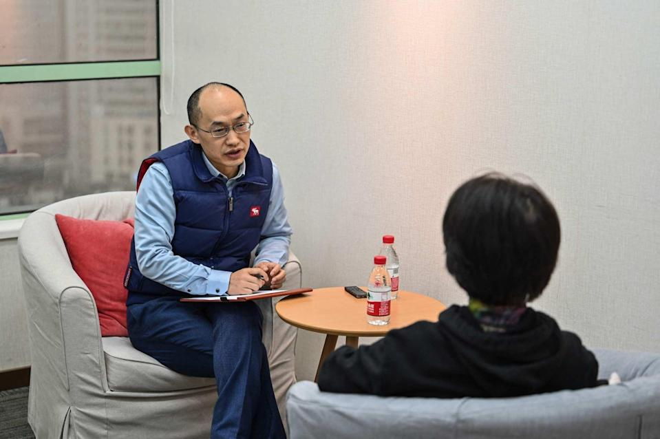 A marriage counsellor advises a client in Shanghai. The government in some Chinese cities provides mediation services for couples during the cooling-off period. Photo: AFP
