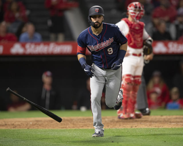 Minnesota Twins' Marwin Gonzalez flips his bat after hitting a two-run home run during the sixth inning of the team's baseball game against the Los Angeles Angels in Anaheim, Calif., Tuesday, May 21, 2019. (AP Photo/Kyusung Gong)
