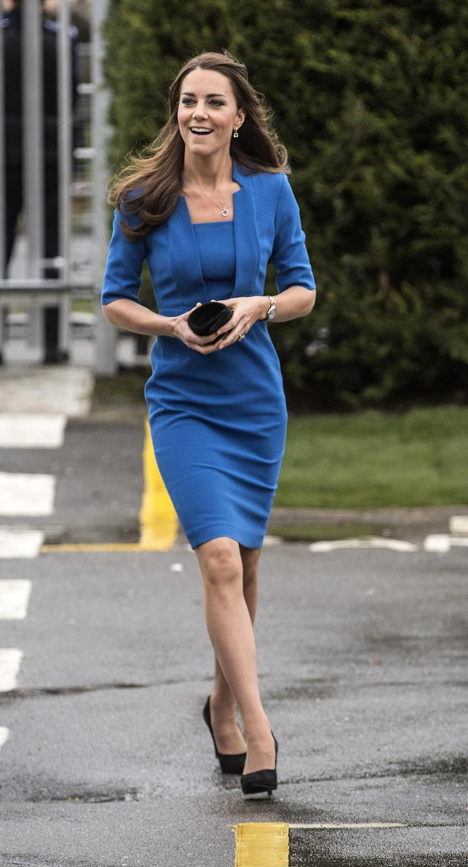 <p>For a London school event, Kate donned an all-blue fitted ensemble by L.K. Bennett with a black clutch, suede pumps and Cartier jewellery.</p><p><i>[Photo: PA]</i></p>