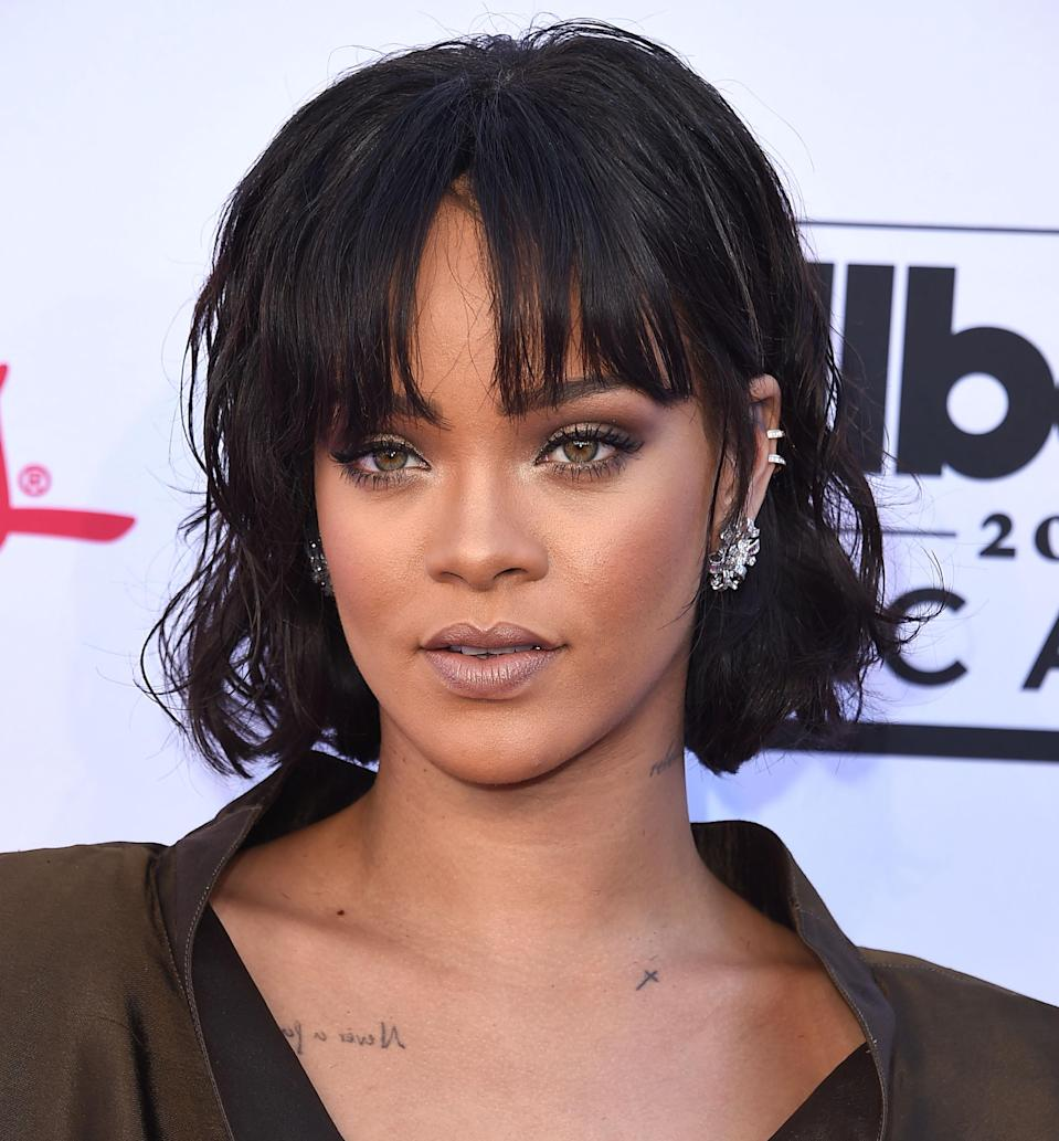 """Not only are they easier to manage, but longer, grown-out bangs are the most flattering on long face shapes. You have the space to work with, plus cropped bangs will only make your forehead look longer. Go for a cool pair of parted bangs like Rihanna's. """"Keeping the fringe line low right around your eyebrows is best,"""" says Reyman. In other words, no need to trim your bangs more than every couple of months."""