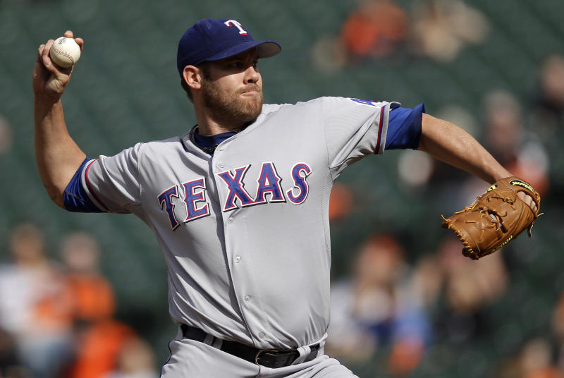 Texas Rangers starting pitcher Colby Lewis throws to the Baltimore Orioles in the second inning of the first baseball game of a doubleheader against the Baltimore Orioles in Baltimore, Thursday, May 10, 2012. (AP Photo/Patrick Semansky)