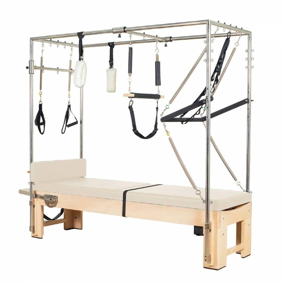 """<p>pilatesreformersdirect.com</p><p><strong>$5250.00</strong></p><p><a href=""""https://pilatesreformersdirect.com/products/elina-pilates%C2%AE-elite-cadillac-reformer?variant=31564726894692&gclid=Cj0KCQjw_ez2BRCyARIsAJfg-ku-6bpDYrI0lxO6Zdpm2zGEwL_4MaZ7BbsjiOxSs8IllfYelyxY_2EaAgkrEALw_wcB"""" rel=""""nofollow noopener"""" target=""""_blank"""" data-ylk=""""slk:Shop Now"""" class=""""link rapid-noclick-resp"""">Shop Now</a></p><p>If you want the full shebang, you can't beat this beauty, so you can practice Pilates at home the way celebs like <a href=""""//www.womenshealthmag.com/fitness/a19973467/kate-hudson-pilates-workout/"""" data-ylk=""""slk:Kate Hudson"""" class=""""link rapid-noclick-resp"""">Kate Hudson</a> and <a href=""""//www.womenshealthmag.com/fitness/g31901842/lady-gaga-workout-routine/"""" data-ylk=""""slk:Lady Gaga"""" class=""""link rapid-noclick-resp"""">Lady Gaga</a> do.</p><p><strong>Reviewer rave:</strong> """"I work out on it every evening before going to bed. It is so relaxing, so challenging and so effective! """" </p>"""