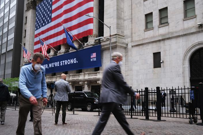 NEW YORK, NEW YORK - MAY 26: The New York Stock Exchange (NYSE) stands in lower Manhattan on the first day that traders are allowed back onto the historic floor of the exchange on May 26, 2020 in New York City. While only a small number of traders will be returning at this time, those that do will have to take temperature checks and wear face masks at all times while on the floor. The Dow rose over 600 points in morning trading as investors see economic activity in America picking up (Photo by Spencer Platt/Getty Images)