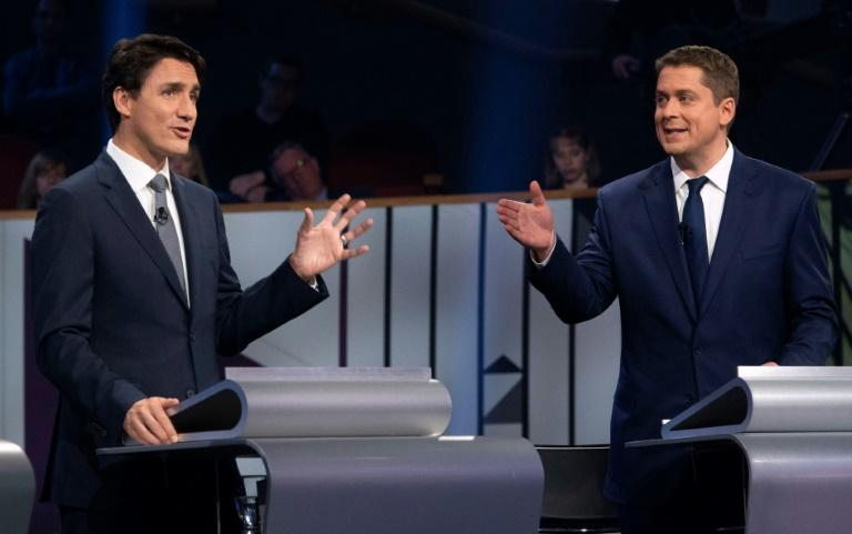 Prime Minister and Liberal leader Justin Trudeau (L) and Conservative leader Andrew Scheer faced off during a debate in Gatineau, Quebec, on October 10, 2019; the two differ sharply on questions of energy and the environment