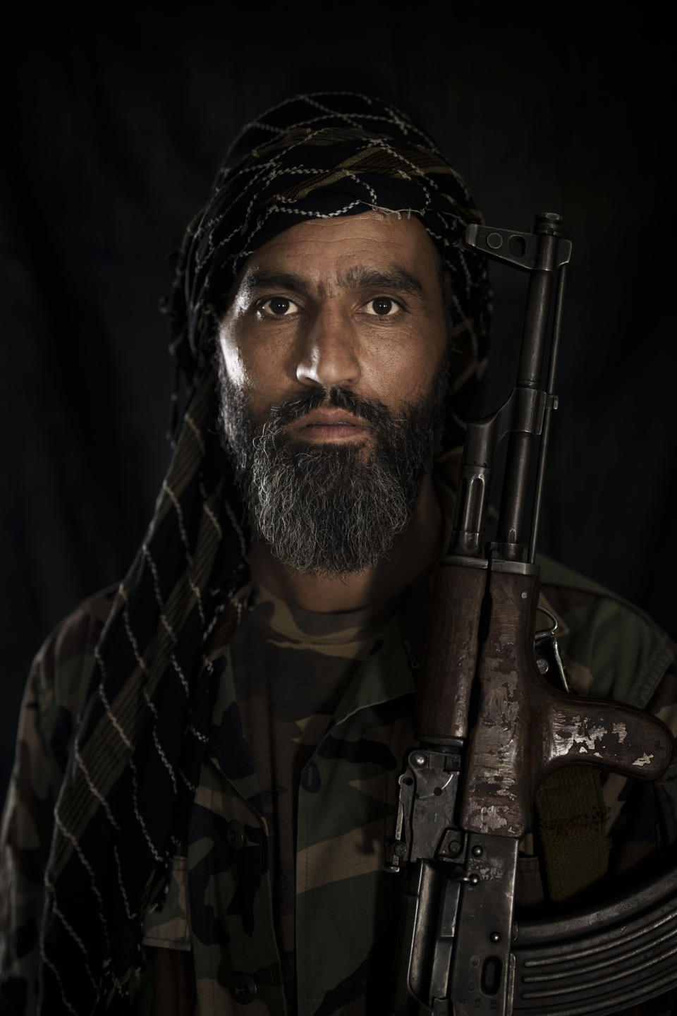 Taliban fighter Briali Badri poses for a photo at a police station in Kabul, Afghanistan, Thursday, Sept. 16, 2021. Badri is wearing the former Afghanistan army uniform he found left behind by soldiers of the previous government after the Taliban took control of Kabul. (AP Photo/Felipe Dana)
