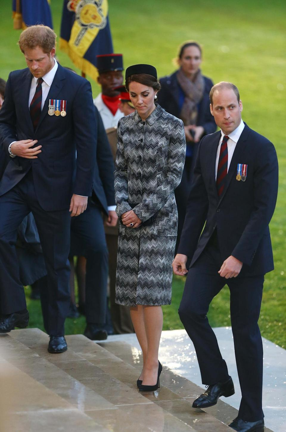 <p>For a second Somme commemoration, Kate chose a long grey Missoni coat stitched to resemble snakeskin. A vintage pillbox hat and faux pearl Balenciaga earrings completed the look.</p><p><i>[Photo: PA]</i></p>