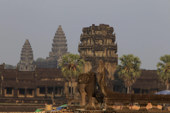 FILE - In this March 3, 2018, file photo, a view from outside Angkor Wat temple is seen in Siem Reap, northwestern Cambodia. Cambodia is closing the Angkor temple complex to visitors because of a growing COVID-19 outbreak. On Thursday, April 8, 2021, the Health Ministry said 113 cases were reported from local transmission, with two deaths. The ministry traced the outbreak to a foreign resident who broke hotel quarantine to visit a nightclub. (AP Photo/Heng Sinith, File)