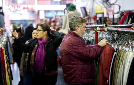 People shop in a used clothing shop in Buenos Aires, Argentina May 14, 2019. Picture taken May 14, 2019. REUTERS/Agustin Marcarian