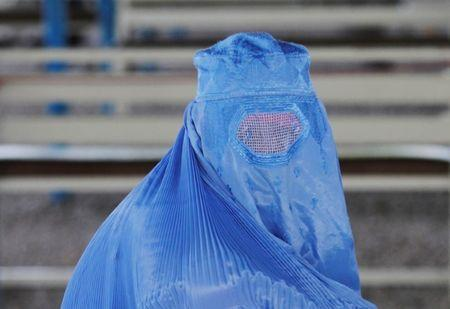 An Afghan refugee woman waits to be repatriated to Afghanistan, at the UNHCR office on the outskirts of Peshawar