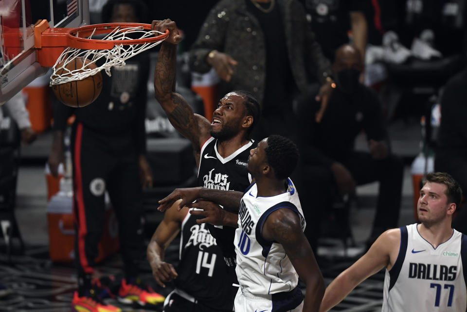 Kawhi Leonard dunks against Dorian Finney-Smith during Game 7 of the Western Conference first-round playoff series at Staples Center on June 6, 2021. (Kevork Djansezian/Getty Images)