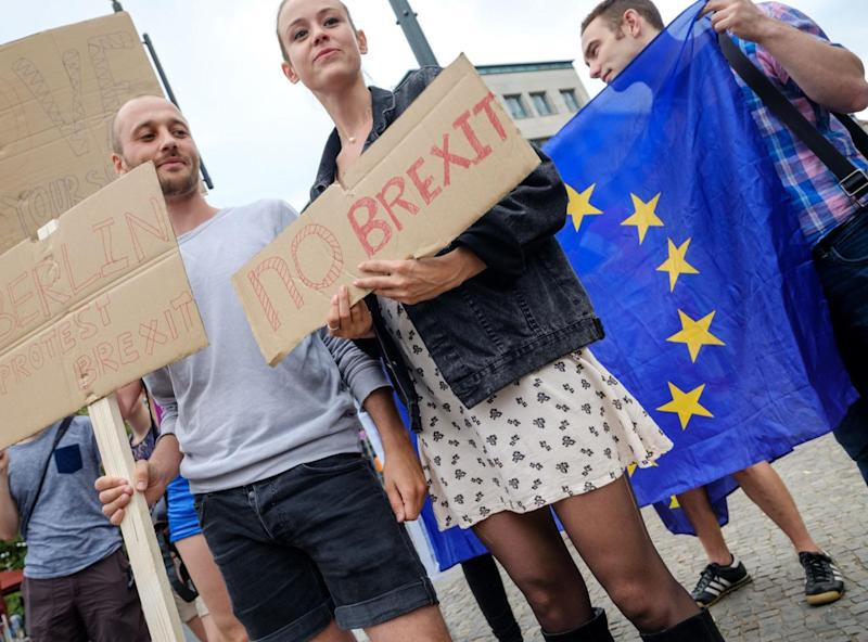British expats hold up signs to protest for the United Kingdom to remain in the European Union on 2 July 2016 in Berlin, Germany (Getty)