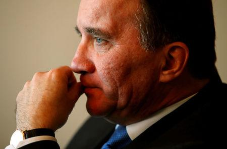 Sweden's Prime Minister Lofven gestures during an interview at the WTO in Geneva
