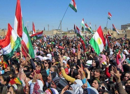 <p>Syrian Kurds wave the Kurdish flag as they rally against the Syrian regime and to mark Nowruz spring festivities in the northern city of Qamishli. The UN Security Council demanded Wednesday that Syria immediately implement a peace plan by special envoy Kofi Annan, even as government forces pounded rebel zones around Damascus and Homs.</p>