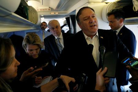 U.S. Secretary of State Mike Pompeo speaks to reporters while his plane refuels in Brussels, Belgium