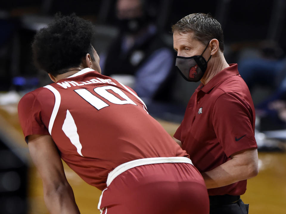 Arkansas head coach Eric Musselman talks with forward Jaylin Williams (10) during the first half of an NCAA college basketball game against Vanderbilt, Saturday, Jan. 23, 2021, in Nashville, Tenn. (AP Photo/Mark Zaleski)