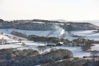 HUDDERSFIELD, UNITED KINGDOM - 2021/01/15: Smoke rises from a chimney in the snow-covered West Yorkshire landscape. Many parts of West Yorkshire are still covered with snow following heavy snowfall the previous day, which caused widespread disruption to travel. (Photo by Adam Vaughan/SOPA Images/LightRocket via Getty Images)