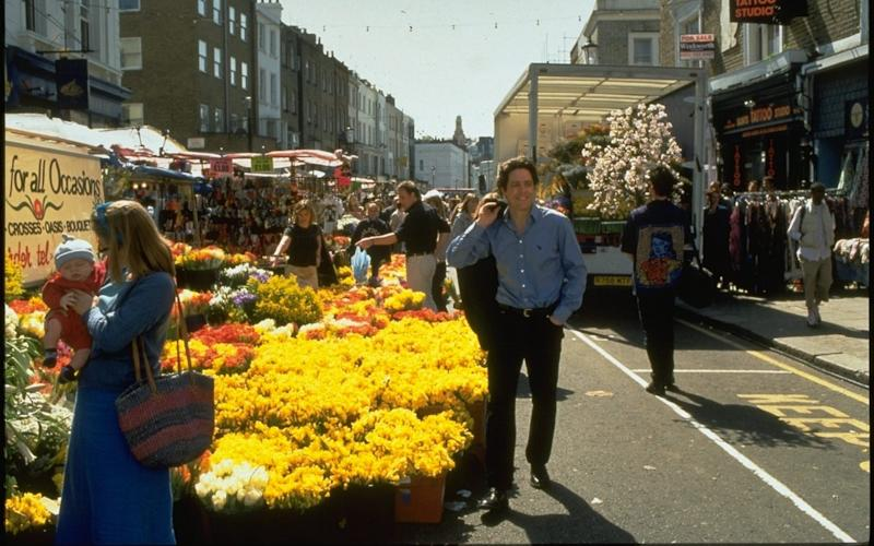 Not real: Hugh Grant swans through Notting Hill in the 1999 film - Credit: Film Stills