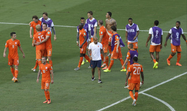 Netherlands' Wesley Sneijder, front left, smiles after the World Cup round of 16 soccer match between the Netherlands and Mexico at the Arena Castelao in Fortaleza, Brazil, Sunday, June 29, 2014. Holland won 2-1 and advanced to the quarterfinal. (AP Photo/Themba Hadebe)