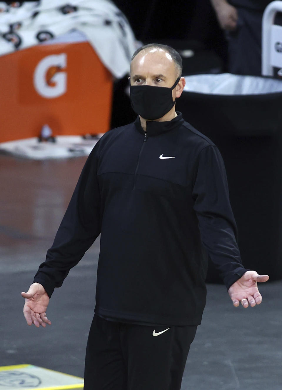 Oregon State head coach Scott Rueck talks with an official during an NCAA college basketball game in the first round of the Pac-12 women's tournament Wednesday, March 3, 2021, in Las Vegas. (AP Photo/Isaac Brekken)