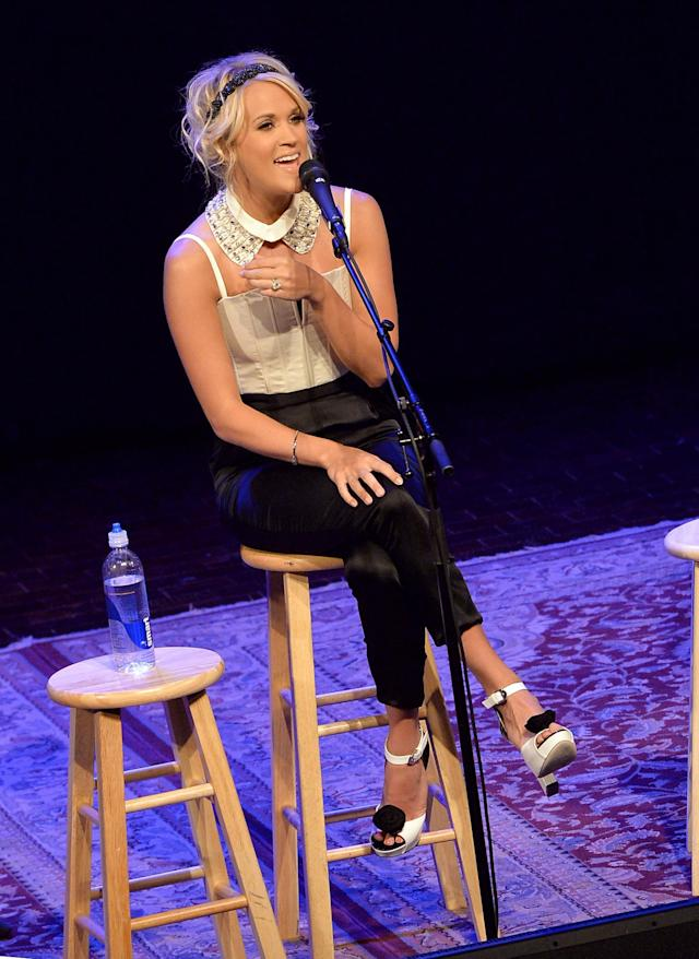 """NASHVILLE, TN - JUNE 04: Carrie Underwood Celebrates No. 1 Song """"Two Black Cadillacs"""" At Exclusive Fan Club Party During 2013 CMA Music Festival Week at Country Music Hall of Fame and Museum on June 4, 2013 in Nashville, Tennessee. (Photo by Rick Diamond/Getty Images for BMI)"""