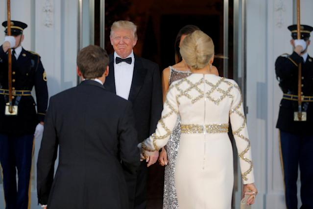 United States President Donald Trump and first lady Melania Trump welcome French President Emmanuel Macron and his wife Brigitte for a State Dinner at the White House in Washington, U.S., April 24, 2018. REUTERS/Brian Snyder TPX IMAGES OF THE DAY