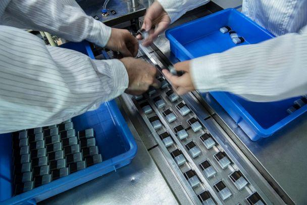 PHOTO: Workers package pods for e-cigarettes by the company Mystlabs on the production line at First Union, one of China's leading manufacturers of vaping products, Sept. 25, 2019 in Shenzhen, China. (Kevin Frayer/Getty Images, FILE)