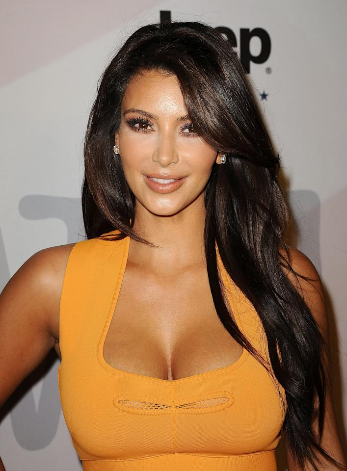 <p>Kardashian looked fresh-faced with peach blush complementing her bronzed skin at an event in 2012. </p>