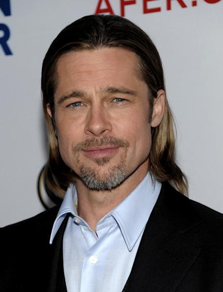 """FILE - In this March 3, 2012 file photo, actor Brad Pitt arrives at the Los Angeles premiere of the play """"8"""" in Los Angeles. Chanel announced Wednesday, May 9, that Pitt will star in an upcoming ad campaign for its signature women's scent. Previously the French-based house had used other famous names as its models, including Catherine Deneuve, Nicole Kidman and Audrey Tautou. (AP Photo/Dan Steinberg, file)"""