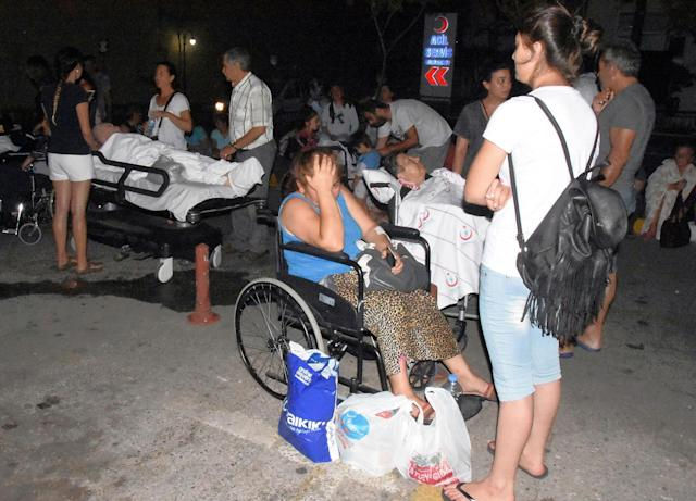 <p>People wait outside the emergency unit of a hospital in Bodrum, Turkey, early Friday, July 21, 2017. (Photo: DHA-Depo Photos via AP) </p>