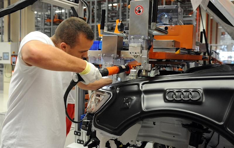 Moving rapidly to cut auto emissions and shift to electric cars could result in the loss of 100,000 jobs in the company's factories, the head of Volkswagen said Thursday. Audi is one of the VW Group's brands