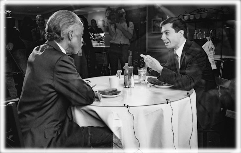 Mayor Pete Buttigieg (D) of South Bend, Indiana and Rev. Al Sharpton are seen at Sylvia's Restaurant as they eat lunch together in Harlem, New York City in April. (Photo: Michael Brochstein/SOPA Images/LightRocket via Getty Images; digitally enhanced by Yahoo News)