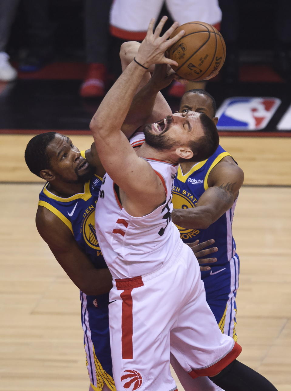 Toronto Raptors center Marc Gasol, front right, is fouled by Golden State Warriors forward Kevin Durant, left, during first-half basketball game action in Game 5 of the NBA Finals in Toronto, Monday, June 10, 2019. (Nathan Denette/The Canadian Press via AP)