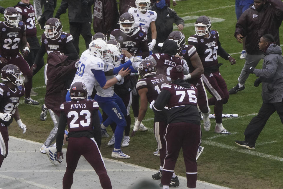 Members of Tulsa and Mississippi State fight after time runs out in Armed Forces Bowl NCAA college football game Thursday, Dec. 31, 2020, in Fort Worth, Texas. Mississippi State won 28-26. (AP Photo/Jim Cowsert)